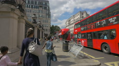 Teens and children walking on Strand street in London - stock footage