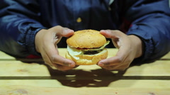 Fast food. The man decides eat or not eat the burger. Difficult choice. Obesity - stock footage