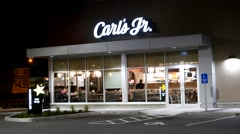 Outside shot of carl's jr restaurant at night in Port Coquitlam BC Canada - stock footage