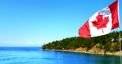 4K Canadian Flag on Stern of Ship, Blowing in Wind, Gulf Islands Stock Footage