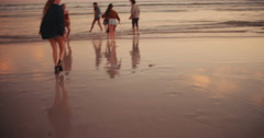 Young adult friends doing funny piggyback rides at the beach - stock footage