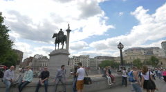 King George IV statue and Nelson's Column in London - stock footage