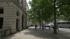 People walking by the Golden Cross House in London Stock Footage