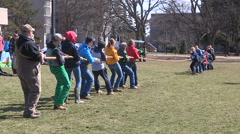 College and university students playing tug of war on campus Stock Footage