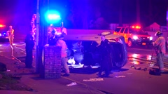 Crash Vehicle  With Emergency Crew And Lights Flashing At Night - stock footage