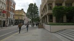 Walking on Long Acre Street in London - stock footage