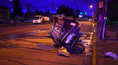 Vehicle On Its Side In Roadway After A Crash  Stock Footage