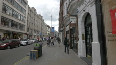 Walking by the shops of Long Acre street in London - stock footage