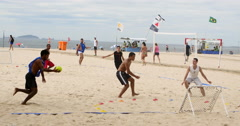 Rio de Janeiro, Brazil. A group of young adults play beach game. Copacabana - stock footage