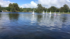 Time lapse of remote controlled sailing wooden yachts race in a pond Stock Footage