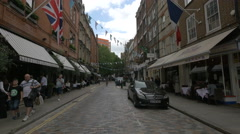 Tourists relaxing on Monmouth St in London Stock Footage