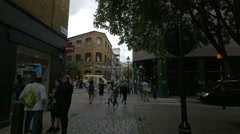 Small road junction with restaurants in London Stock Footage