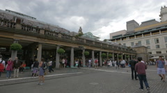 Many tourists visiting in Covent Garden in London Stock Footage