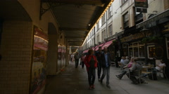 People walking on St Martin's Court in London - stock footage