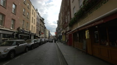 Old Compton Street with restaurants in London Stock Footage