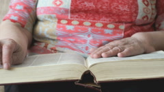 Hands of the old woman holding a book Stock Footage
