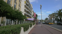 Outdoor restaurant in front of Le Royal Hotel in Nice Stock Footage