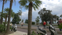 Tourists and locals walking on Bay of Angels in Nice Stock Footage