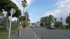 Walking and driving near the Jardin Albert I on Bay of Angels in Nice Stock Footage