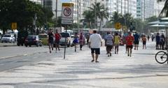Stock Video Footage of Tourists walking on the famous Copacabana beach, Rio de Janeiro, Brazil