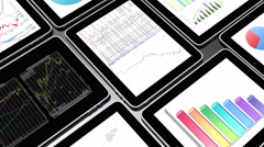Stock Video Footage of 4k Mobile devices,finance pie charts & stock trend diagrams in the ipad.