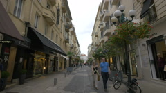 People walking on Rue Paradis, on a cloudy day in Nice Stock Footage