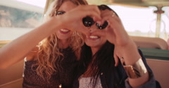 Two Hipster Girls Posing for Photo Making Hand Heart Stock Footage