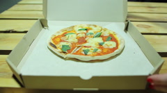 Pizzeria joke. Unexpected trick from deliveryman. Small pizza. Disappointment Stock Footage