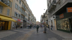 Walking by Hype shoe store and other shops on Rue Massena in Nice - stock footage