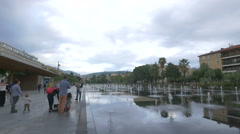People walking by Miroir d'eau in Nice Stock Footage