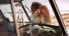 Road trip Hipster Couple Hugging in front of Sandy Beach Stock Footage