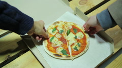 Hungry friends taking  pieces of small pizza. Friendship. Fairness. Tasty food Stock Footage
