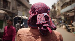 A day in the life on an Indian Street - rickshaw rider in the old part of Delhi - stock footage