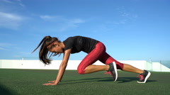 Fitness woman strength training doing cardio workout with fast mountain climbers Stock Footage
