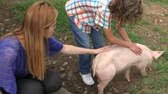 Kids Playing With Pig Stock Footage