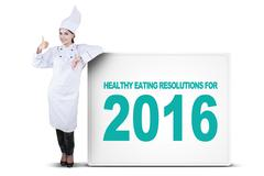 Chef with OK sign and healthy eating resolutions Stock Photos