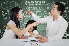 Couple quarrel in front of their child - stock photo