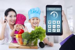 Healthy family and weight loss app - stock photo