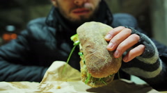 Healthy lifestyle and food. Vegetarian sandwich. Man eating tasty ciabatta Stock Footage