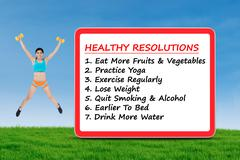 The list of healthy resolutions and fitness woman - stock photo