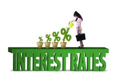 Woman with percentage sign of interest rates - stock photo