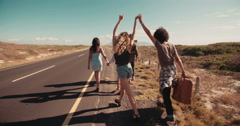 Two Multi-Ethnic Female Hipster Girl Friends Hitchhiking to Las Vegas Stock Footage