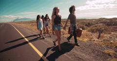 Hipster Multi-Ethnic Group Walk Down Highway Shoulder Together Stock Footage