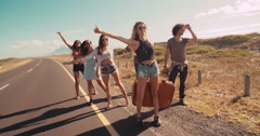 Hipster Multi-Ethnic Group Walking Down Open Road Stock Footage