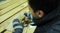 Scrupulous worker eating sandwich with vegetables and cheese. Healthy food Stock Footage