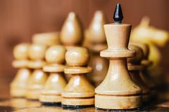 Old Chess Standing On Wooden Chessboard Stock Photos