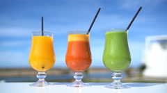 Healthy eating juicing concept - fruit and vegetable juice glasses Stock Footage