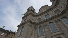Low angle view of the facade of Saint Jakob Cathedral in Innsbruck Stock Footage