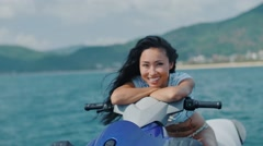 asian girl riding her jet ski - stock footage