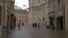 People walking on Pfarrgasse near Saint Jakob Cathedral in Innsbruck Stock Footage